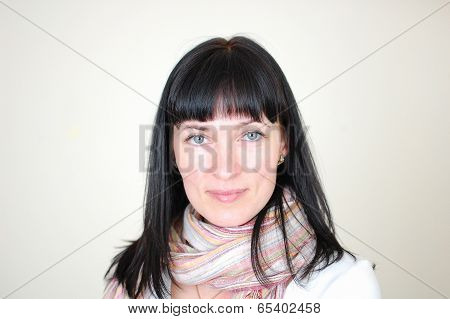 portrait of pretty woman wearing neckpiece isolated against grey background