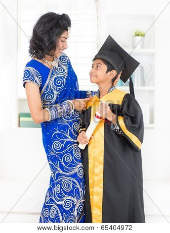 Kindergarten graduation. Asian family, Indian mother and son on kinder graduate day.