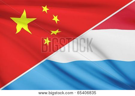 Series Of Ruffled Flags. China And Grand Duchy Of Luxembourg.