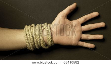 Hand With A Rope With Black Background