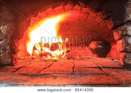 Cooking in traditional hearth furnace