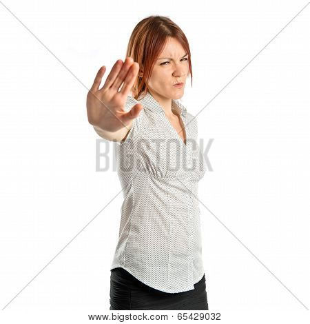 Pretty Woman Making Stop Sign Over White Background