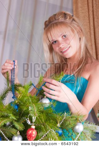 The Girl Decorates Fur-tree Branches