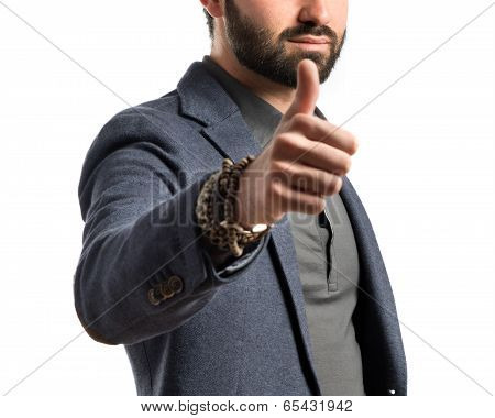 Businessman Making An Ok Gesture Over Isolated White Background