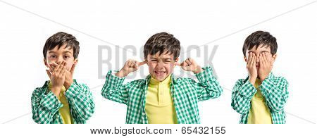 Boy Covering His Eyes, His Mouth And His Ears