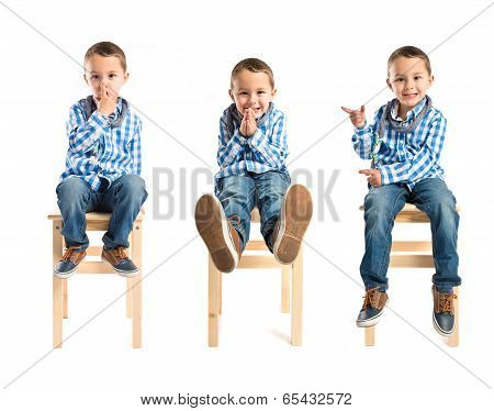 Kid Doing Silence Gesture, Pleading Gesture, And Pointing To The Left