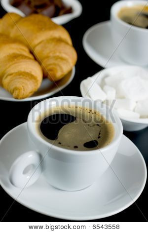 Cup Of Coffee With Chocolate, Sugarcubes And Croissants