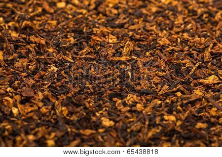 Background is of chopped tobacco leaves.