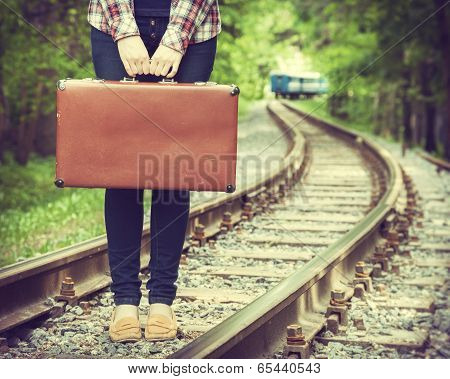 Young Woman With Old Suitcase On Railway poster