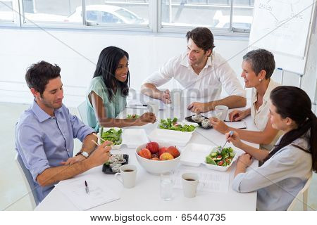 Business people eating lunch together in the office