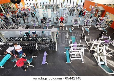 MOSCOW, RUSSIA - MAY 8, 2014: Fitness center Gold Gym with traineger equipments. In Russia, Gold Gym opened in 1996.