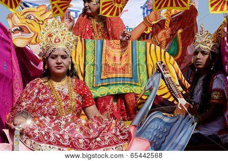 woman and man dressed as hindu gods at Pushkar camel fair,India