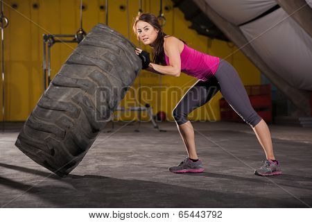 Strong Girl Flipping A Tire