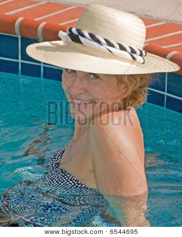 Senior Woman Relaxing In Pool