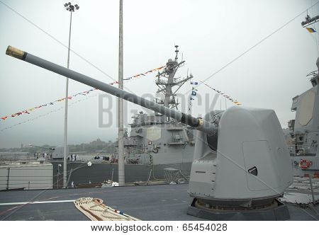Turret containing a 5-inch gun on the deck of US Navy guided-missile destroyer USS McFaul during Fle