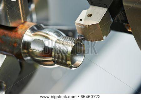 milling detail on metal cutting machine tool at factory