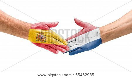 Handshake Spain and Netherlands on a white background