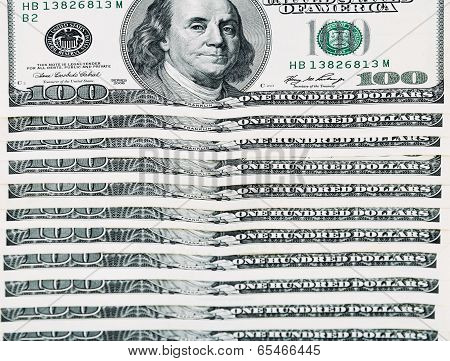 100 Dollar Bills Arranged Horizontally