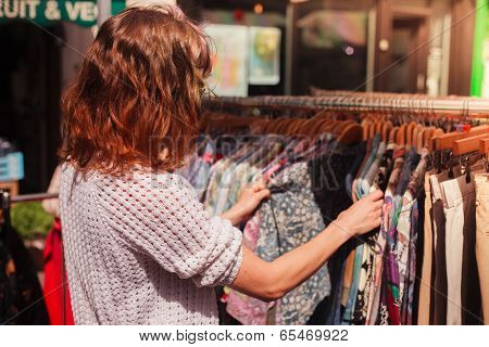 Woman Browsing Clothes At Market