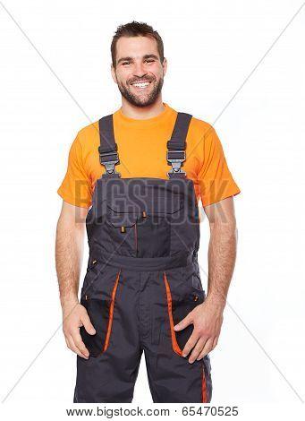 Portrait Of Smiling Worker In Uniform