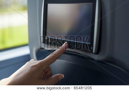 Woman Touching Multimedia Screen At Bus