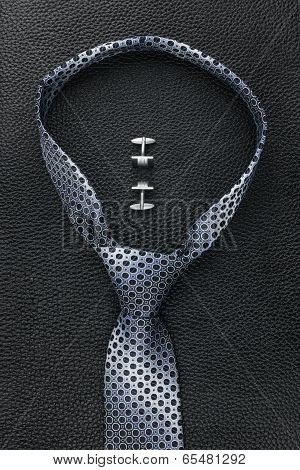 A Necktie And  Cufflinks  Lying On The Skin