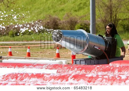 Woman Sprays Foamy Bubbles At Crazy Obstacle Race