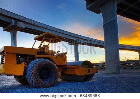 Bulldozer Tank Road Construction Machine Against Dusky Sky And Infra Construction Of Express Way