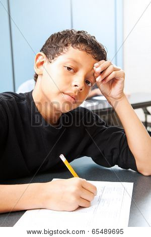 Teen boy worried about taking a standardized test.