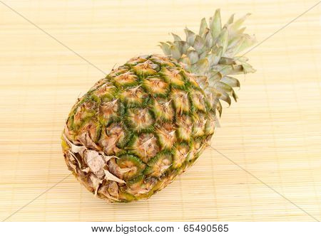 Pineapple on bamboo mat
