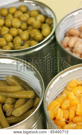 Open tin cans of peas, corn, bean and french bean close-up