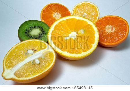 lemons and tangerines,kiwi  - fruit, light background