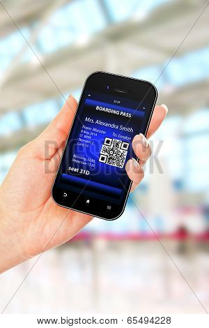 Hand Holding Mobile Phone With Mobile Boarding Pass