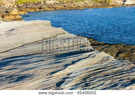 Rippled Rock Beside Vivid Blue Sea