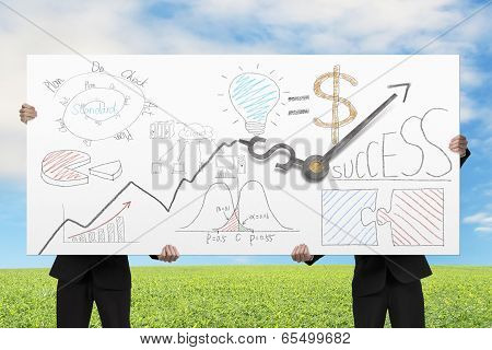 Businessmen Lifting Board With Clock Hands And Business Doodles