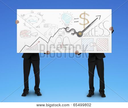 Two Men Holding Board With Business Doodles And Clock Hands