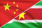 image of suriname  - Flags of China and Republic of Suriname blowing in the wind - JPG