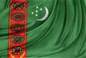 stock photo of turkmenistan  - Closeup of silky Turkmenistan flag - JPG