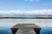 picture of pier a lake  - Pier under low clouds on a bright blue lake
