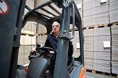 stock photo of forklift  - Forklift driver inside a forklift - JPG