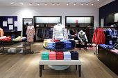 picture of traditional dress  - luxury and fashionable brand new interior of cloth store - JPG