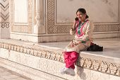 stock photo of salwar  - Dressed in the traditional indian pantsuit