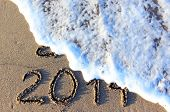 image of happy new year 2013  - Happy New Year 2014 replace 2013 concept on the sea beach - JPG