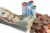 picture of twenty dollars  - Stack of American twenty dollar bills and rolls of USA coins - JPG