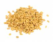 stock photo of fenugreek  - A pile of fenugreek seeds isolated on a white background - JPG