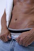 image of jock  - Man unbuttoning his jeans - JPG