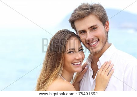 Happy Couple With A White Smile Looking At Camera