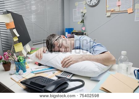 Office Worker Sleeping On Desk