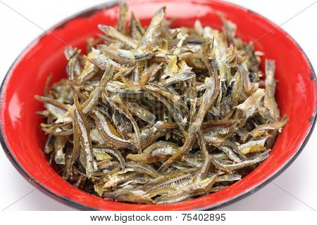 fried ikan bilis(dried anchovies) , malaysian food isolated on white background