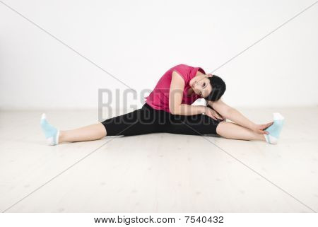 Woman Fitness On White Laminate Flooring